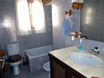 Full bathroom suite - Bath, basin, loo, bidet, over-bath shower, towels etc. Tiles by Pierre Cardin!