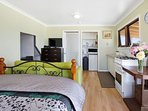 interior with equipped kitchen and comfortable queen size bed and ensuite bathroom