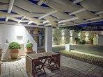 Mykonos Art Villas outdoor sitting & dining area 2 with pergola. Night