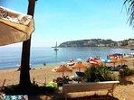 idyllic beach with sunloungers
