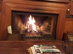 An open log fire with a glass of red says it all