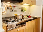 The kitchen with cooker hob and sink