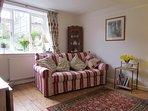 Living room showing window onto garden