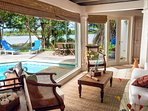 Living room overlooking the pool and the lagoon