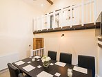 Dining room space - 8-seater table, double height room with balcony