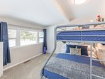 Guest bedroom featuring twin over full bunk bed., features room darkening draperies.