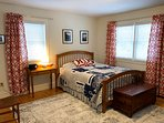 Master bedroom with cedar chest at the foot of the bed.