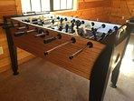 Loft gaming area includes pool table, foosball & 55' HDTV