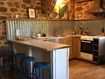 Along with the breakfast bar- the farmhouse offers dining table and chairs to seat 6