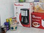 Kitchen: Coffee maker, toaster, hand mixer, coffee, tea (cinnamon and black tea) and sugar