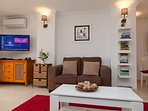 Comfortable lounge with flatscreen TV