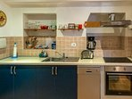 The kitchen area has fitted units and equipped with electric cooker, extractor fan and dishwasher.