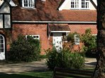 Stable Cottage at Holmfield  overlooking secluded lawns, gardens & woods where deer can roam at dusk