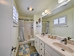This spacious bathroom boasts everything you need to stay fresh for daily exploits.
