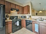 The kitchen comes fully equipped with modern appliances.