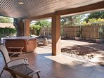 covered patio with hot tub