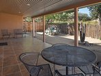 dining table and seating area under covered patio