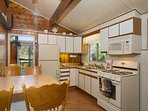 Kitchen with dining area and gas range