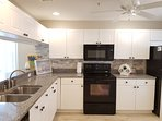 Full kitchen with granite counter tops and stone back-splash. All full size appliances.