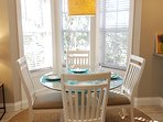 Dining area is surrounded by large bay windows looking onto the preserve and the lake.