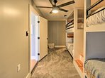 The 4th bedroom features Fixer Upper-inspired full-over-full bunk beds.