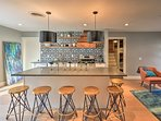 Savor your culinary creations around the 6-person kitchen island.