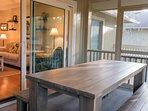 A large farmhouse table seats 8.