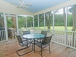 This cottage has a screened porch overlooking the 7th green of Ocean Winds.