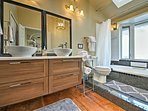 Sink into the en-suite bathtub and relax.