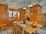 Host family dinners around this classic wood dining table set for 6.
