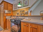 Fully equipped, the kitchen features all of your essential appliances.