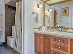 This en-suite bathroom is highlighted by double sinks and a tub/shower combo.