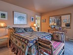 The master bedroom boasts a flat-screen cable TV and full en-suite bathroom.