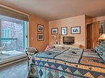 After a long day of skiing, seek comfort on the queen bed in the master bedroom.