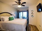 Master bedroom has balcony access and a view of the beach