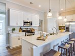 Stool seating and ample counter space for meal prep