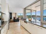 Sleek, modern kitchen with harbour views