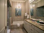 First floor en-suite master bathroom with double vanities, indulgent soaker tub and large walk-in shower