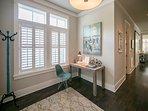 Bright entryway with tall ceilings and inviting warm colors welcome you into this beautiful beach home; powder room in...