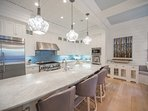 Open-concept to the main living and dining rooms the kitchen has Calcutta marble countertops and an extra large island...