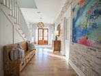 Bright grand entry featuring beautiful Chicago-style brick and sight-line straight into the main living area