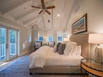 King Suite over the garage with vaulted ceilings overlooking pool and large walk-in closet