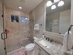 Bathroom with large walk-in shower between the Twin and Queen bedrooms