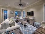 Plenty of seating for the whole crew in the living room with access to the screened-in porch
