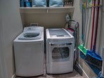 Convenient full-sized washer and dryer on first floor in hallway complete with vacuum and broom