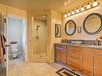 Find a double vanity and walk-in shower in the en-suite bathroom!