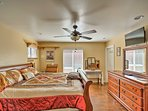 The master bedroom houses a king bed and wood furnishings.