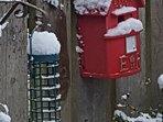A garden birdhouse in winter.