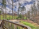 Enjoy beautiful forest views from your private deck and fire pit area.