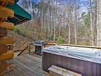 Enjoy unwinding on the covered front deck with a hot tub.